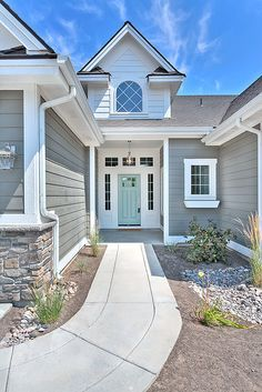 Clark and Co. Homes Exteriors - Amherst Gray by Benjamin Moore with front door painted Wythe Blue