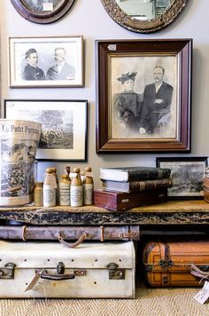 vignette of old photos and suitcases.