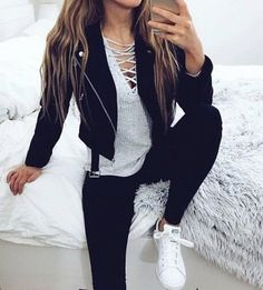 Leather jacket, sweater, leggings/black jeans, converse