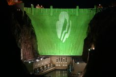 In celebration of the 100th anniversary of Girl Scouts of the USA, March 12, 2012, the Bureau of Reclamation displayed the Girl Scout logo against a sea of green light on the Hoover Dam.