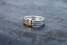 Sterling silver and gold ring. Unique silver rings. Gold and silver ring. Hammered silver band ring.  Silver and gold wedding band. Handmade by JaneFullerDesigns on Etsy https://www.etsy.com/listing/169862343/sterling-silver-and-gold-ring-unique