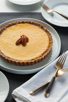 Carrot Ginger Tart (Raw, Vegan, Paleo) This creamy carrot-ginger tart with its cinnamon pecan crust is a nice alternative to pumpkin pie for your holiday table.