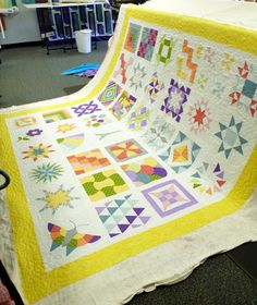 Beautiful, colorful with lovely quilting.