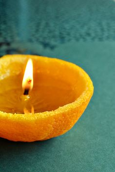 Orange candle. Fill peel with olive oil no need for a wick. Use the pith in the middle of the orange for your wick. Do not leave unattended. It will burn for a few hours