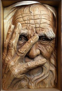 Old Man's face carved out of Wood