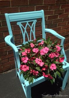 So, here it is now, repurposed as a plant stand. I found a 16in. hanging basket at Home Depot for around $11 and purchased a can of Rust-Oleum's Painter's Touch in Aqua (Satin) to paint it with. The color really brightened it up and how can you go wrong with impatiens?