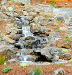 A fun Pondless Waterfall we created.  Pondless features are great for small yards, people with kids or animals and for those who don't want the maintenance hassles of a traditional pond.