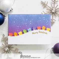 This morning, I woke up to a scene not that dissimilar to this card. Maybe not the rainbow of houses, but there's a lot of snow! I don't usually get much snow where I live so it was a surprise to l…