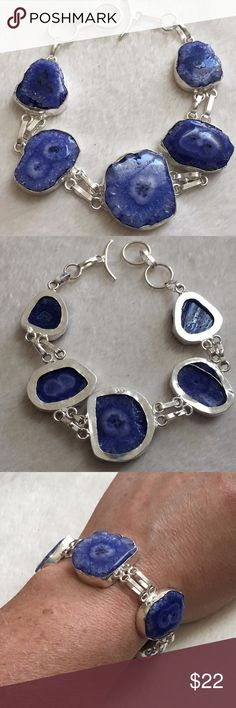 """Blue-Purple Solar Quartz & 925 Silver Bracelet Very pretty and natural looking piece. Blue-purple solar Quartz set in 925 Sterling silver. Adjustable length from 7 3/4"""" to 8 1/2"""" in length. Please note these stones can't always be polished due to the size of the stone and the alinement  of the crystals. Boutique Jewelry Bracelets"""