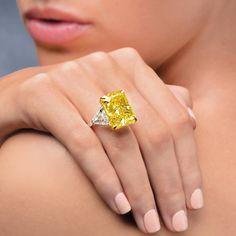 Superb 26.25 carat Fancy Vivid Cushion Cut Yellow Diamond Ring by Ronald Abram
