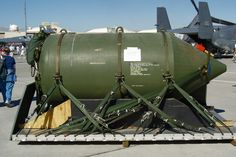 """An inert demonstrator BLU-82B bomb, known under its program name """"Commando Vault"""" and nicknamed """"daisy cutter"""" in Vietnam for its ability to flatten a section of forest into a helicopter landing zone, leaving radial blast-zone """"petals"""". The munition was a 15,000 pound conventional bomb, delivered from either a C-130 or an MC-130 transport aircraft. The BLU-82B was retired in 2008 and replaced with the more powerful MOAB."""