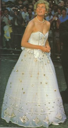 white with gold beading on this dress makes me think Duchess Catherine may have been referencing her when she wore her white and gold number on the Singapore Jubilee Tour.