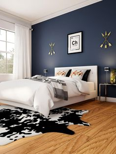 Overhaul your bedroom to get this rustic look. Layer the look up from the floor - here, we use oak and cowhide. Then, a modern side table and simple bed frame keep the focus on color and texture, like…More Master Bedroom Color Schemes, Modern Bedroom, Home Bedroom, Bedroom Interior, Rustic Bedroom, Blue Bedroom Walls, Bedroom Color Schemes, Remodel Bedroom, Master Bedroom Colors