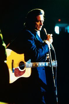 In 1980, Johnny Cash was inducted into the Country Music Association Hall of Fame, becoming the youngest person to do so.  (© Bettmann/CORBIS)