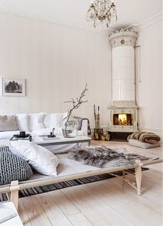 An Elegant Swedish Space in Neutrals | The high ceilings, the beautiful wood floor, the original kakelugn (tiled fireplace). The space oozes elegance and serenity.