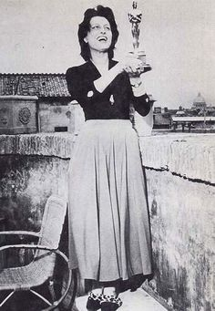 """Anna Magnani in Italy admiring her Oscar for """"The Rose Tattoo""""."""