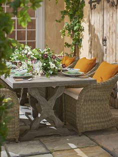 Bring the tropics to your outdoor dining table. Add a selection of OKA accessories - exotic candles, some decadent leafy tableware and a sumptuous array of flowers.
