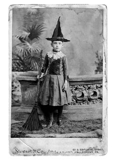A great vintage photo of a little girl wearing her Halloween costume. Witch outfit...