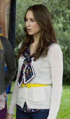 Spencer's key print bow top with white cardigan and yellow bow belt on Pretty Little Liars. Outfit Details: http://wornontv.net/18178/ #PLL
