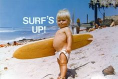 The surfboard is the perfect size for this surfin' toddler!