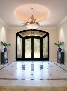 Traditional Entryway with French doors, Stained glass window, complex marble tile floors, Pental calacatta gold honed marble Foyer Design, Entrance Design, House Entrance, Window Design, Entrance Hall, Classic House Design, Dream Home Design, Modern House Design, Village House Design