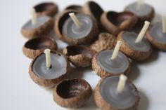 Sweet and simple, these little candles are perfect for fall dinner parties or just a special evening at home. The length of burn time varies with the depth of the acorn cap so keep an eye out for the big ones for a longer use time. Here's what you'll need: