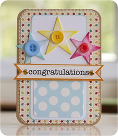 Love the quirky combinations of patterned paper on this handmade card.  Punched stars with matching buttons and the bling on the Congratulations banner complete the look.