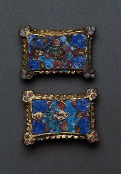 Viking age brooches in gilded bronze and enamel, Björkö, Sweden.