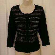"Black beaded zip up cardigan Black zip up cardigan win beading detail from WHITE HOUSE BLACK MARKET  Size LARGE  Busy (underarm to underarm - UNSTRETCHED): 40"" Length (shoulder to hem): 23"" Sleeve length ( shoulder to cuff): 18""  With beading and ribbon detail on front. Zip front fastening.   Knit portion: 72% rayon, 28% nylon. Woven portion: 100% polyester.   In excellent gently used condition. No stains, tears, holes or fading. From a smoke free home. White House Black Market Sweaters…"