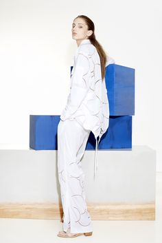 Tibi Resort 2016 look 4. Head-to-white has never looked as effortlessly cool thanks to neutron and proton inspired cutouts on an easy, athletic shaped jacket and pants.