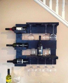 This beautiful wine rack is made from reclaimed pine that I have painted black and distressed. It measures x with 3 shelves and wine glass holder. This rustic wine rack will look great in any room! Wall Bar Shelf, Glass Wall Shelves, Bar Shelves, Hanging Wine Rack, Wine Rack Wall, Wine Glass Shelf, Wine Glass Holder, Wood Wine Holder, Wine Bottle Storage