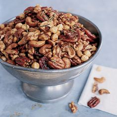 A holiday party favorite. Union Square Cafe's Bar Nuts Recipe with Rosemary. I use all cashews vs mixed nuts.  I melt the butter with the brown sugar (to disolve) and toss with nuts, then toss in the remaining ingredients and bake. I bake an additional 5-10 minutes (being careful not to burn) for a deeper more carmelized flavor.