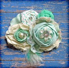 Mint Green, Ivory, Cream Vintage Hair Accessory, Shabby Chic Headband, Baby Girls Hair Bow, Fabric Flowers, Floral Brooch. $27.50, via Etsy.