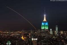 Veteran launch photographer Ben Cooper captured this spectacular photo of NASA's LADEE moon probe soaring across the night sky from Top of the Rock, Rockefeller Center, in New York City, about 200 miles north of the launch pad at NASA's Wallops Flight Facility on Wallops Island, Va., on Sept. 6, 2013. A Minotaur V rocket launched the LADEE probe at 11:27 p.m. EDT.