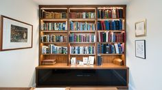 Beautiful integrated lighting on this bespoke library bookcase.