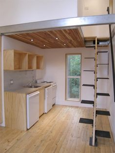 Kitchen area with space saving staircase