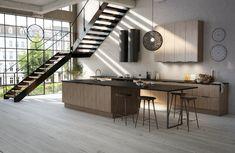 Moderne kjøkkenmodell med slette og slitesterke melaminbelagte fronter i stående trestruktur. Fåes i modellene Lys Alm, som har en blond og nordisk tekstur, eller Mørk Alm med umiskjennelig preg av eksotisk edeltre og Trøffelgrå.