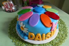 This colorful cake made by Brenda, a troop leader is the perfect addition for your Daisies!