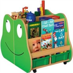 http://www.sensoryedge.com/frog-mobile-book-storage-center.html  Froggy fun is just a hop, skip and jump away with the delightful Frog Mobile Book Storage Center. Francisco the Frog invites children to explore a good book or play with one of the toys he holds all around his frog self!