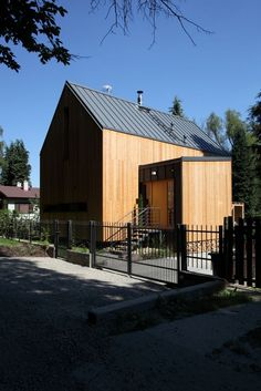 Stribrna Skalice House / Prodesi | Domesi.  The lines are sharp and the colors are so warm.