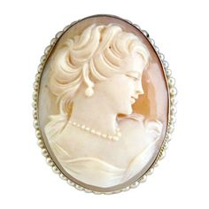 Carved Cameo Pendant/Brooch Of A Beautiful Woman Wearing A Strand Of Pearls And Pearl Earrings, Set In 800 Sterling Silver Frame Surrounded With Seed Pearls   c.1940's
