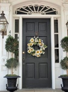 I'm totally painting my front door black... I LOVE the look. I'm going to do it without the hubby knowing... I wonder how long it will take him to notice... LOL!!!