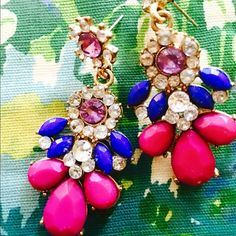 Charming, colorful chandelier/dangling earrings The metal is gold but it's barely noticeable behind all of these cute beads and rhinestones. Perfect pop of prettiness to make your ensemble sing! Jewelry Earrings