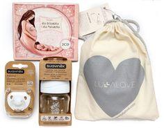 Zestaw kilku produktów zapakowanych w kartonowe pudeło polecane jako prezent z okazji pojawienia się dziecka i Babyshower
