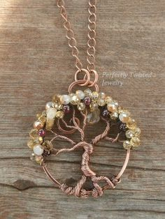 Wire Wrapped Tree of Life Bonsai Pendant Citrine & Crystal Gemstone Jewelry Handmade Antiqued Copper Wire Tree Jewelry Perfectly Twisted  The pendant is 1 3/4 inches in height and approximately 1 3/4 inches wide at the widest point. It comes with a 18 inch solid copper chain and handmade clasp.  This unique and gorgeous Bonsai has a generous canopy of beautiful Citrine and Crystal beads. Each are carefully sewn into place for durability as well as beautiful placement.  This pend...