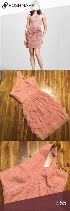 BCBGMAXAZRIA Pleated Ella Dress SZ 2 BCBGMAXAZRIA Pleated Ella Dress SZ 2   EUC - worn once, no stains, rips, damage.   Beautiful pleated dress in dusty rose color, perfect for all types of events !   * Pleated, fanned chiffon. * One shoulder neckline; adjustable strap. * Seamed waist. * Fitted silhouette. * Rounded skirt hits above knee; back zip. * Polyester. * Imported. BCBGMaxAzria Dresses One Shoulder