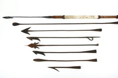 Sale 229 Lot 109 Lot consisting of (8) early hand forged iron whaling harpoons, including: (1) with full wood handle, painted canvas sections, and Turk's heads; (6) with hand wrought tips only and various heads; and (1) with cannon fired tip and double toggle tip. #whaling #harpoon #nauticalantique