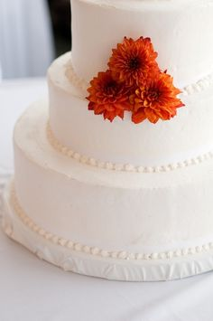 Orange or Mustard Spider Mums as a cake topper. Perfect for a fall wedding, or an orange themed wedding
