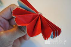 How to make Mexican tissue flowers -- it's so easy! If you can fold and cut, you can make these flowers for your fiesta.
