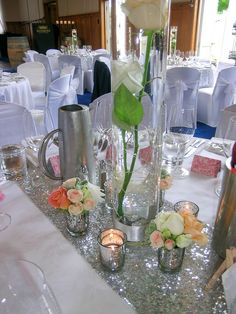 Silver tea lights and posies of peach and pink surround tall cylinder vases of long stemmed roses with floating candles on silver sequinned table runners by I Do Glamour - Wedding of Matt and Sarah, December 2015 - crisp white with glam silver sequins and peach and pink flowers - Mission Estate Winery, HAWKES BAY